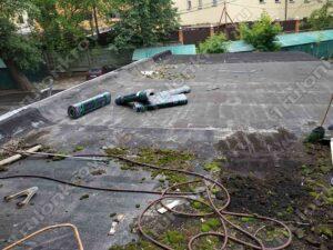 Демонтаж строительного мусора на крыши гаража